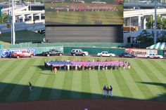 Firemen, policemen, and EMT's hold the 9/11 Star Spangled Banner Flag during the National Anthem at Bisons First Responders Night