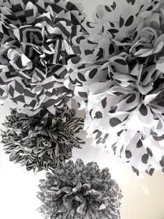 Something like these mixed with paper lanterns for ceiling decor