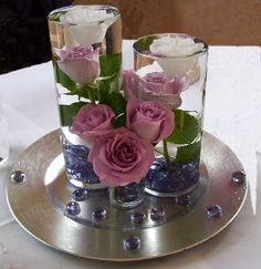 petals in vases floating | Awesome Blossoms Wedding Florist | reception