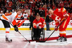 Canadian paralympian Rick Hanson drops the ceremonial first puck on February 25, 2012.