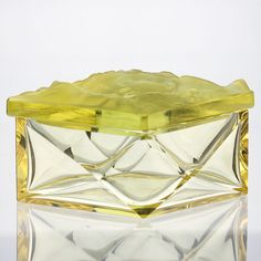 A splendid rhomboid shape citrine glass box and cover, the latter moulded in high relief and acid finished with the. Bohemia Glass, Mosaic Tiles, Mosaics, Glass Boxes, Glass Dishes, Covered Boxes, 1930s, Glass Art, Perfume Bottles