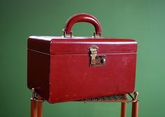 lipstick red train case...I wanted a little one for Christmas, they were called 'choo choo' purses...I got a huge red train case but carried it to school like a purse when I was in the 1st grade...I was a NERD!