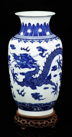 Chinese 18th/19th C. Blue and White Vase. Blue and white porcelain baluster vase, China, 18th/19th century, decorated with a five-clawed flying dragon chasing a pearl in the clouds, Qianlong mark on base, on teak wood stand.