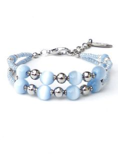 Blue bracelet with ice blue cat's eye beads and seed beads. Handcrafted wristband, silver-coloured beads, dividers, lobster clasp (Bazzano)