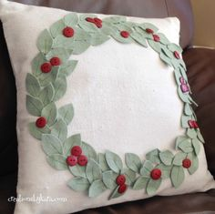 Making a copy of a Pottery Barn pillow--detailed instructions.  I used darker green leaves and red pom poms.