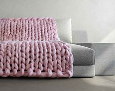 Ukraine-based designer, Anna Mo - the knitting queen behind Etsy store Ohhio - is responsible for creating the world's* cosiest blankets.