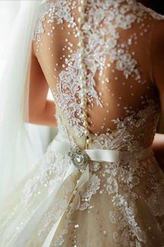 Gorgeous beading and lace/embroidery on the back of a dress bodice