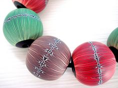 Polymer clay hollow beads, via Flickr.