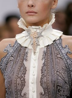 Absolutely beautiful top, wish that halters looked good on girls with broad shoulders so I could wear this beauty well.
