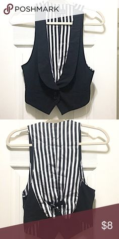 Black Women's Vest w/ Black-White Stripes on Back Cute black vest with black and white vertical stripes on the back with buckle to adjust size. Materials: 64% polyester and 33% rayon. Back lining is 100% polyester. Forever 21 Other