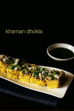 instant khaman dhokla recipe with step by step photos - khaman dhokla or khaman as its called, is a savory steamed cake made from gram flour. khaman is soft and fluffy, mildly tangy-sweet and a great snack