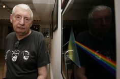 "This July 24, 2008 file photo shows English graphic designer Storm Thorgerson standing next to his album cover artwork for Pink Floyd's ""The Dark Side of the Moon"" during the opening of his exhibition 'Mind Over Matter: The Images of Pink Floyd' in London. Storm Thorgerson, whose eye-catching Pink Floyd and Led Zeppelin album covers captured the spirit of 1970s psychedelia, died on April 18, 2013."