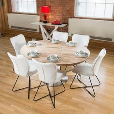 Modern dining set round/oval extending table plus 6 high white chairs 4114. High quality round/oval extending dining table with white gloss and stainless steel base with 6 modern white chairs with black frames. This lovely table features a stainless base, white gloss central pedestal and 3D oak veneer top which is very robust and low maintenance. Call 02476 642139 or email sales@quatropi.com or visit www.quatropi.com for additional information.