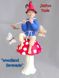 """Jethro Toule  """"Woodland Serenade""""  $50.00  The air currents gently carry the tune throughout the woodlands.  The slight disturbance in the air draws the moths to dance and flutter in glee around the lone figure atop the toadstool.  All is natural in the woodlands this day!"""