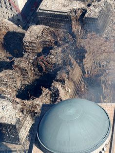 9-11 Aftermath ~ Pinners have raised an interesting question as to why the dome in the foreground has no dust on it...
