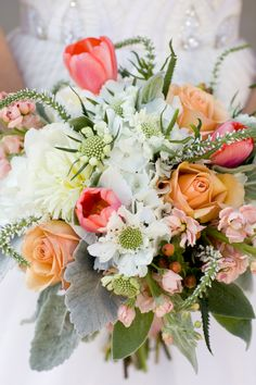 Soft and romantic bridal bouquet with white, pale pink, soft orange and sage green. Flowers by Enchanted Florist, photo by Brooke Boling