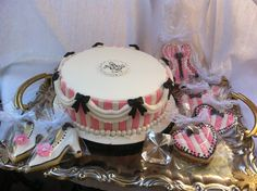 """Bridal shower """"boudoir"""" theme cake and cookies by Donna Belle Desserts. Pink, white and black boudoir themed cake and cookies. Cake is pink velvet with vanilla buttercream."""