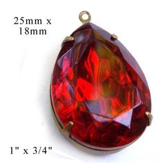 Ruby red rhinestone pendant, $4.19 in silver or brass setting