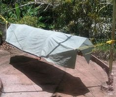 """This is a camping tent hammock I made about 20 years ago. It is made of nylon and was stored away from light, which helps explain its good condition.  It uses flexible 3/4 inch PVC pipe for the stretcher bars. The curve is adjustable by adjusting the length of the center end rope."""