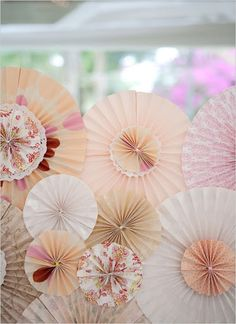 I made some paper rosettes like this, out of vintage dictionary paper, and some of my patterned scrapbook paper.