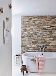 Bring stone to the walls in your bath.  Get it in your house some how...Bath with stone wall