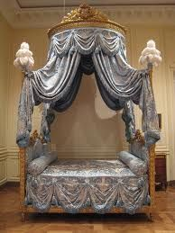 Antique canopy bed in blue French silk