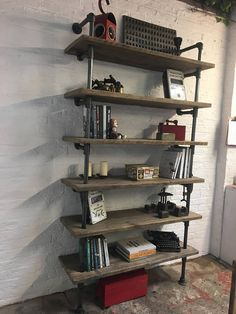 Annabel Bespoke Reclaimed Scaffolding Boards and Dark Steel Pipe Shelving/Bookcase - Its salvaged vintage industrial design works perfectly in a sophisticated, casual living space. This shelving system can be made to measure to your own specifications. The shelves pictured here