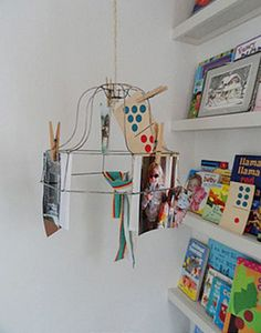 display on lamp shade frame using wooden clothes pins. Hang bobbles, vintage glass ornaments, etc.
