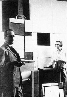 Piet Mondrian and Pétro (Nelly) van Doesburg in Mandrian's studio at Rue du Départ, Paris. 1923. Photo. Published (in altered form) in De Stijl.  Gorgeous.