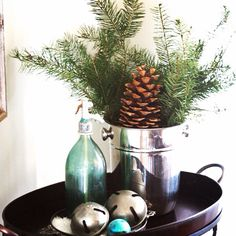 Champagne chiller from #Goodwill filled with winter greens. #thrift #decor #home