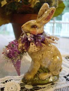 bunny holding Tussie Mussie cone - reminds me of the baby bunnies eating blossoms in my garden. Ah Spring!