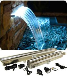 Our pool waterfall weir are made of stainless steel and creates a impressive water blade effect in your swimming pool or pond. Water Wall Fountain, Water Fountain Design, Patio Fountain, Fountain Lights, Garden Water Fountains, Modern Outdoor Fountains, Indoor Pond, Diy Water Feature, Pool Landscape Design