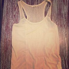 LA Made Crochet Tank BRAND NEW, never worn! Great lightweight tank for Summer!! Classic cream color with a crochet detailed straps and strip down the back! 35% Cotton, 55% Polyester, & 10% Linen. LA Made Tops Tank Tops