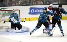 San Jose Sharks goaltender Antti Niemi + defenseman Marc-Edouard Vlasic eye an incoming shot on goal during the third period (Oct. 5, 2013).