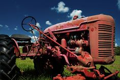 Fine art photograph of a rusty and abandoned Farmall tractor set against a beautiful blue sky. The chipped paint and patina lend the Farmall a lot of character. Chipped Paint, Farmall Tractors, Country Life, Fine Art Photography, Abandoned, Monster Trucks, Photographs, Sky, Wall Art