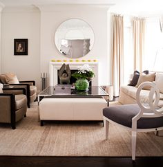 Powell and Bonnel Design Inc. Lovely living room with understated elegance. Nice choice of art placement. Sunken Living Room, Living Room Bedroom, Living Rooms, Interior Design Portfolios, Luxury Interior Design, Grey Sectional Sofa, Round Storage Ottoman, Classic Living Room, Lounge