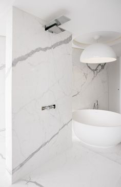 An elegant pair: this shower and bathtub feature Fantini Milano fixtures. Flagship Penthouse, designed by Fantini Design Awards winner Adam Becker Design.