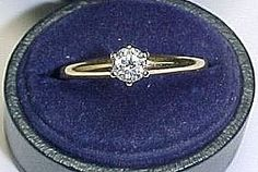 Diamond Solitaire Ring in Two Tone Gold Setting