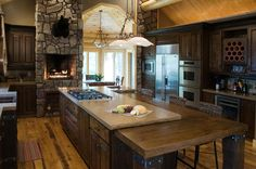 awesome-rustic-kitchen-design-featuring-natural-stone-wall-decoration-ideas-and-cool-white-glass-pendant-lighting-over-large-rectangle-dark-brown-finish-oak-wood-kitchen-island-with-beige-marble-grani.jpg 1,200×798 pixels
