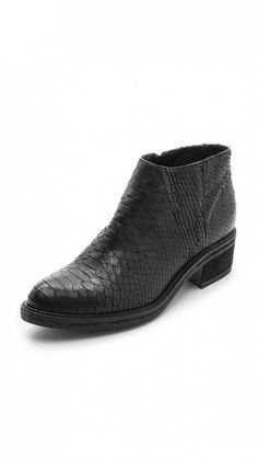 Snake-embossed leather ankle boots will add instant cool to any outfit. // Ankle Booties by Vic Italy