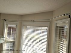 DIY Window Treatment for Bay Windows made using conduit & spray paint. Worthwhile to consider for our bay window, but not sure will work given that our window doesn't bump out. Best ides is likely just a straight curtain rod w/ mounts & tie backs.