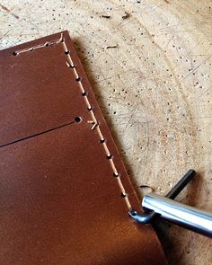 Before you start stitching your leather, make a stitch groove, this will allows the thread to snug in the groove, your leather wallet or lea. Leather Carving, Leather Art, Sewing Leather, Leather Design, Leather Tooling, Leather Jewelry, Leather Wallet, Custom Leather, Handmade Leather