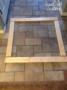 DIY Bathroom Mirror Frame. No mitering! Use wood glue and a staple gun! Sawdustsisters.com