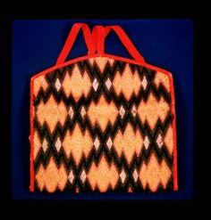 Canvaswork purse or pocketbook with rose cambric lining, red binding and two compartments. Body is covered in flamestitch in blue, green, black, tan and yellow. Diamond zig-zag pattern.Probable DateLate 18th century