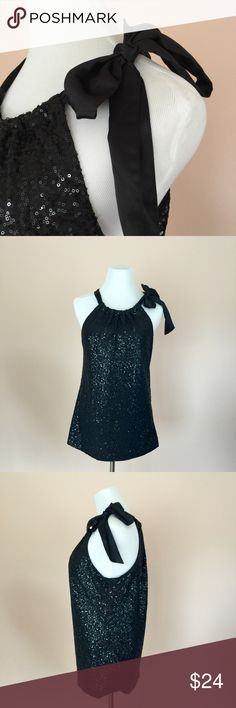 """Tahari Black Sequin Tank Top Ribbon Detail Sz M This listing is for a  beautiful black sequined tank top by Tahari with satin ribbon detail at shoulder in size medium.  Top is fully lined.  *fabrics - 95% polyester 5% elastane *wash instructions - hand wash cold on gentle, lay flat to dry *measurements - chest 37"""" with lots of stretch length 26"""" *non-smoking home.  Tank will be delivered beautifully wrapped in tissue. Tahari Tops Tank Tops"""