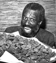 Famous Amos smiles with his famous  chocolate chip cookies (March 17, 1983). | Florida Memory
