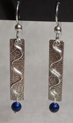 Sterling Silver Meander-style earrings with Lapis Lazuli beads.