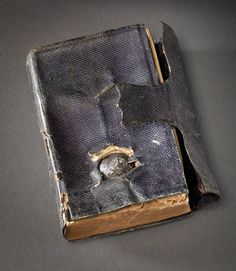 theoddmentemporium:  Bullet in a Bible  A soldier during the Civil War had his life saved by the Bible in his pocket.  He wrote to President Lincoln about it, and the President sent him a replacement with the Presidential signature.