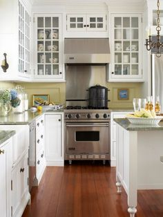 1885 Victorian kitchen updated - Yellow paint with light counters, white cabinets, and warm wood floor