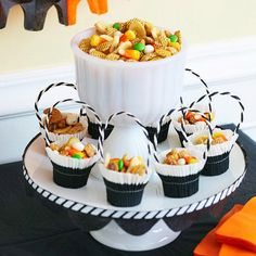 Nothing scary about this hauntingly easy snack. Cereal, peanuts, yogurt-covered raisins, and banana chips combine for a tasty treat. Add candy corn for extra Halloween attitude. Editor's Tip: For a Halloween party display, layer black and white cupcake liners, and machine-stitch through both layers to craft tiny snack baskets. Thread a length of black-and-white covered wire or pipe cleaner through opposite sides of the baskets to serve as handles./